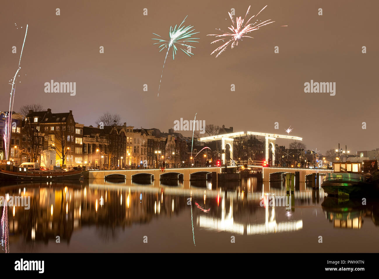 Amsterdam with firework on New Year's Eve/turn of the year.. Stock Photo