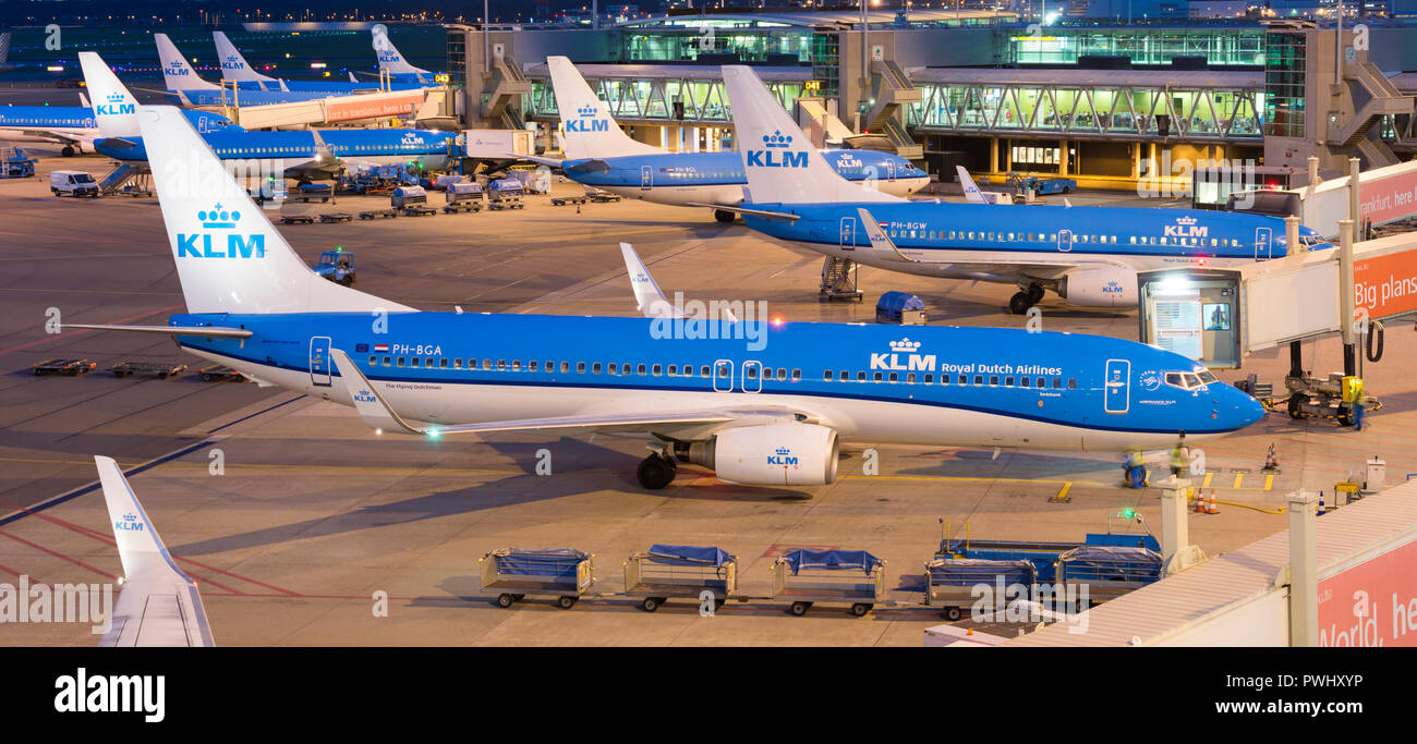 Amsterdam Airport Schiphol (Luchthaven Schiphol). In front a Boeing 737 of KLM (Royal Dutch Airlines/Air France KLM) - Stock Image