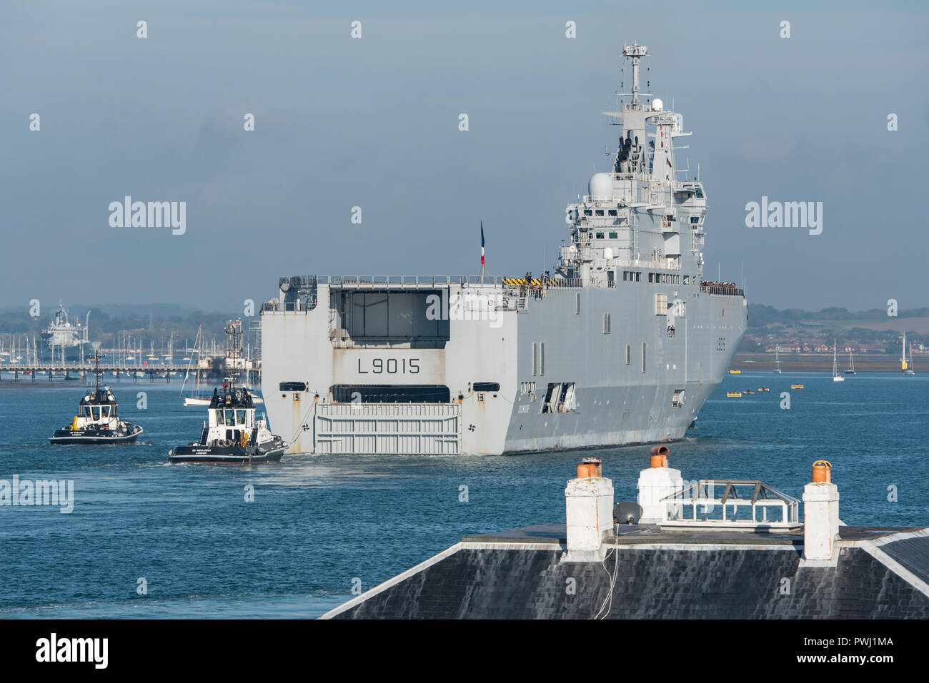 The French Navy 'Mistral' class amphibious assault ship FS Dixmude arrives for a short visit to Portsmouth, UK to load troops & equipment on 16/10/18. Stock Photo
