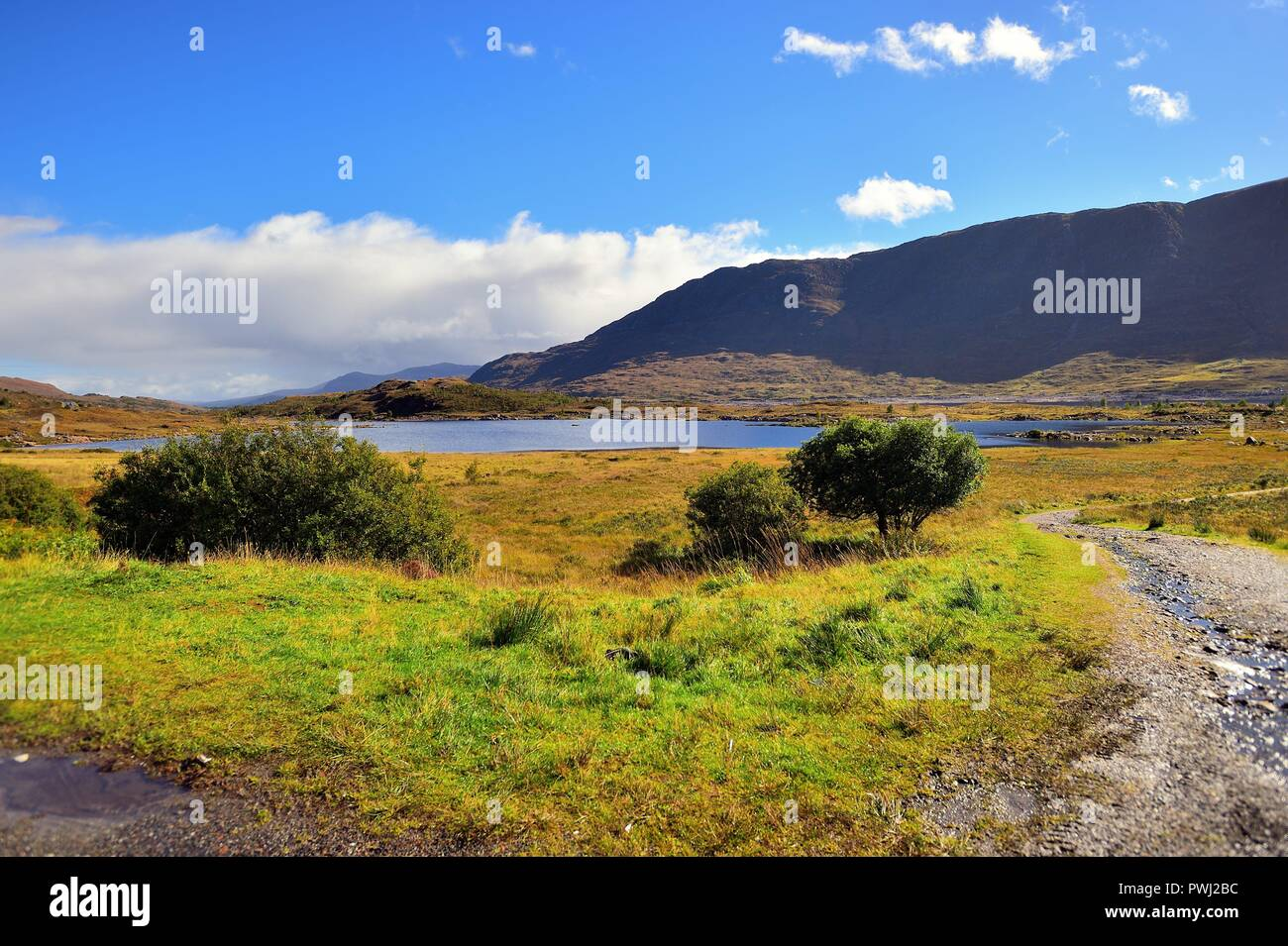 Bun Loyne, Highlands, Scotland, United Kingdom. The beauty of the Scottish Highlands is apparent in this early autumn scene near Loch Cluaniee. - Stock Image