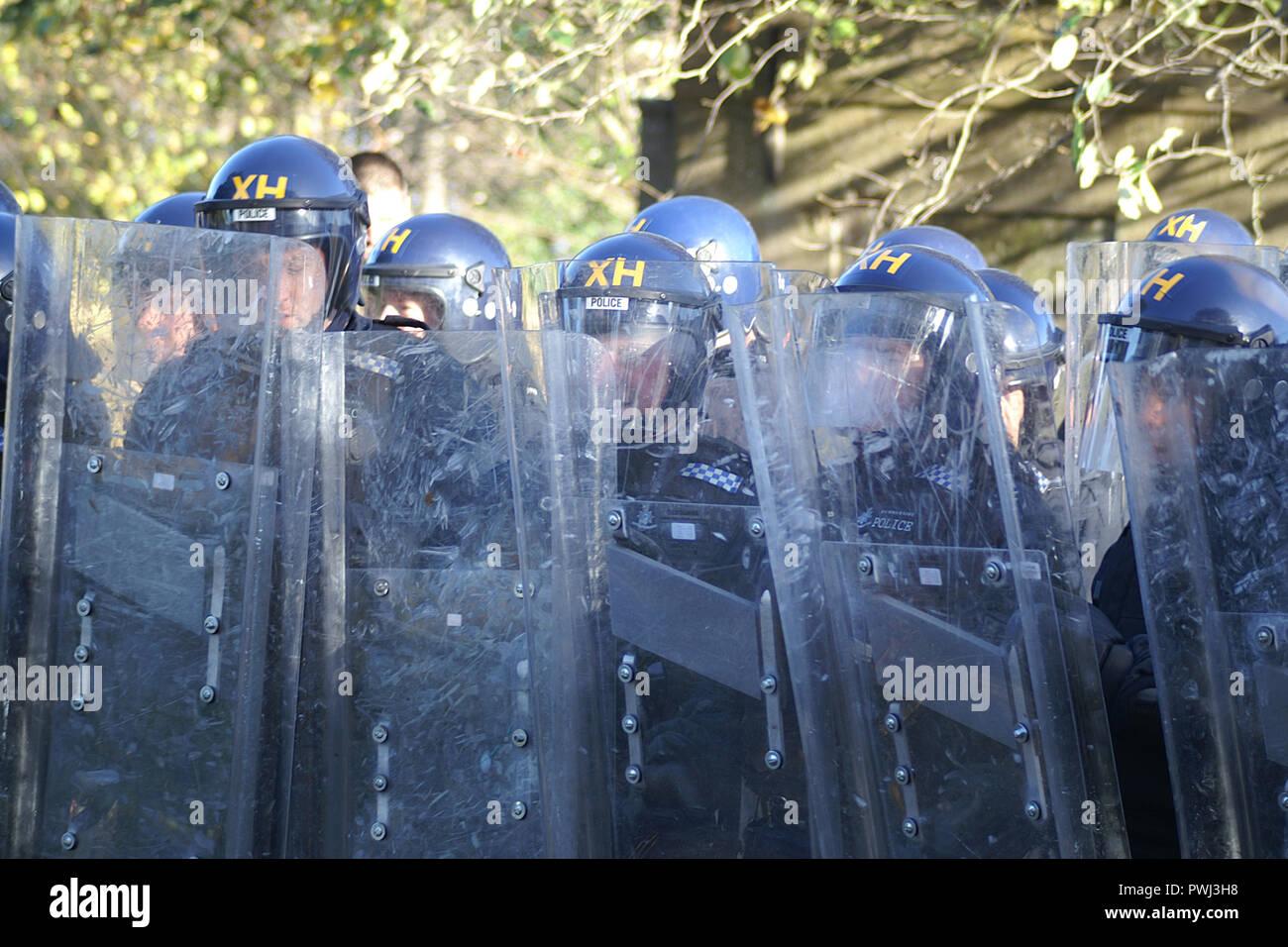 CROWD CONTROL public disorder, street riot, civil unrest, riot police unit - Stock Image