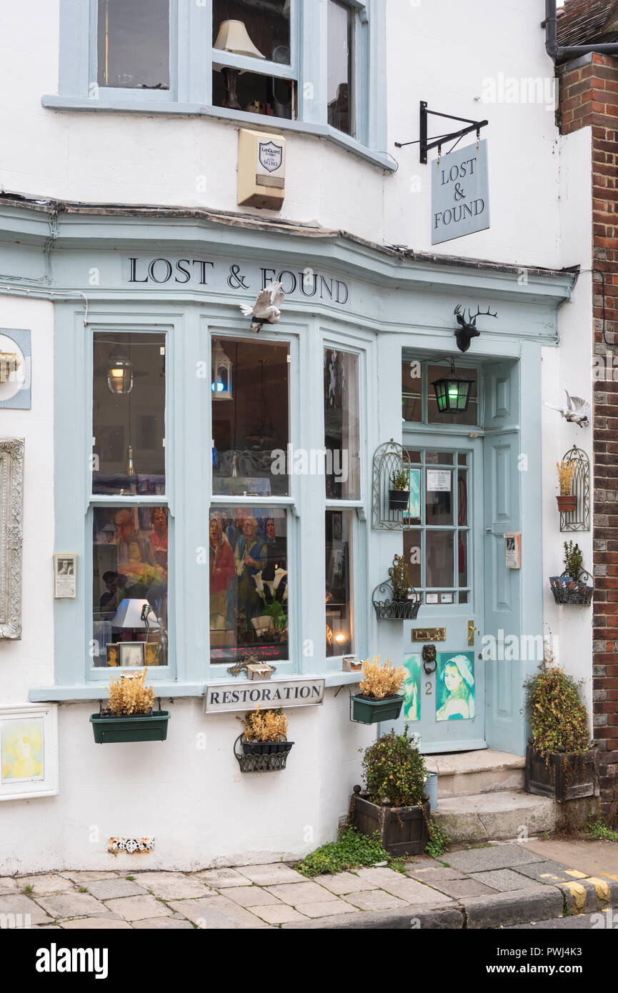 Lost & Found shop, a small British village store doing art restoration in Arundel, West Sussex, England, UK. - Stock Image