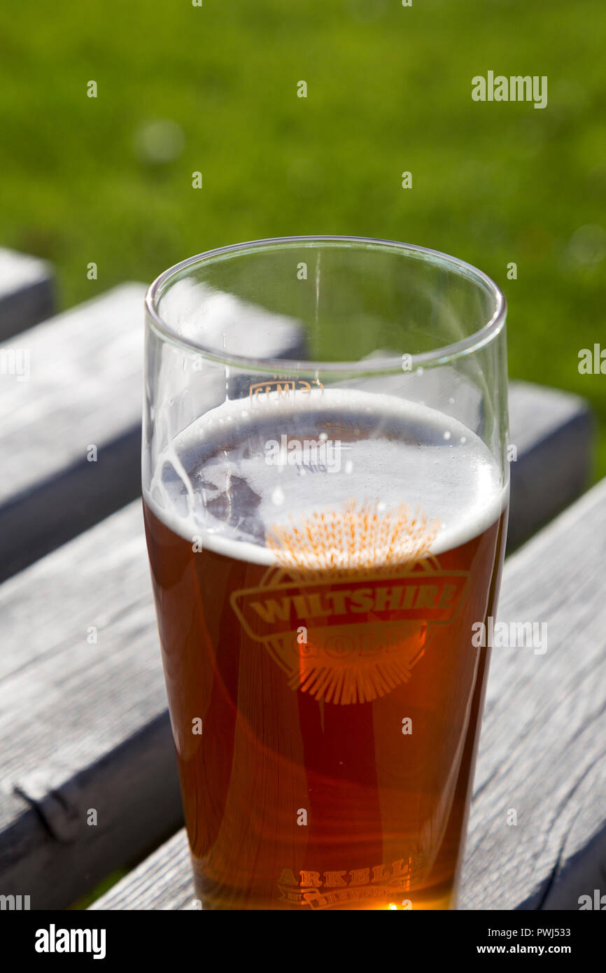 Pint glass of Arkell Wiltshire Gold real ale beer, Wiltshire, England, UK - Stock Image