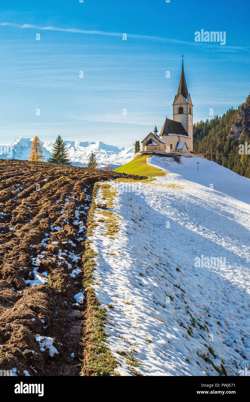 The church of the little village of Schmitten surrounded by snow Albula District Canton of Graubünden Switzerland Europe - Stock Image