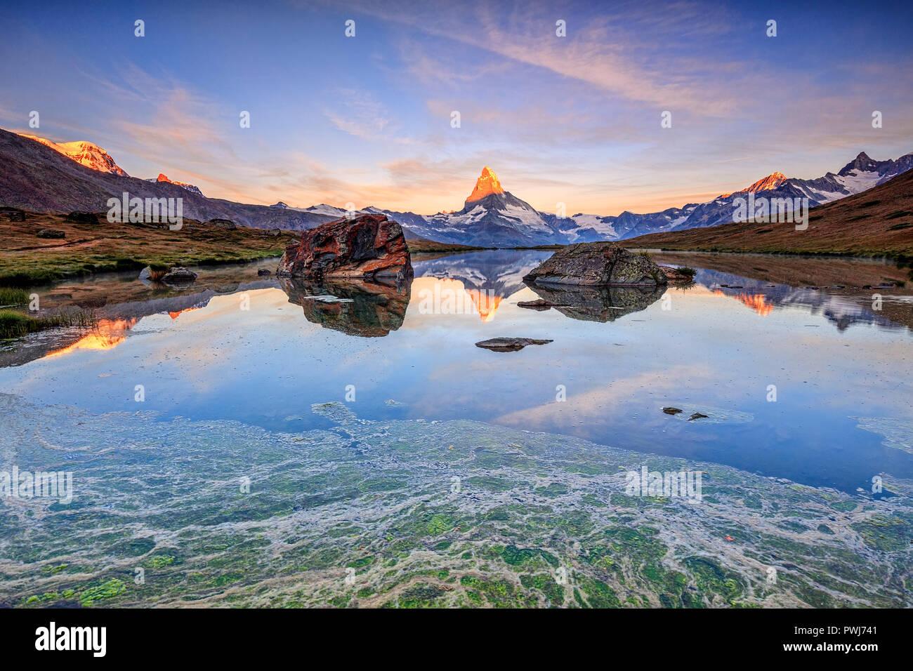 The Matterhorn reflected in Lake Stellisee at dawn Zermatt Pennine Alps Canton of Valais Switzerland Europe Stock Photo