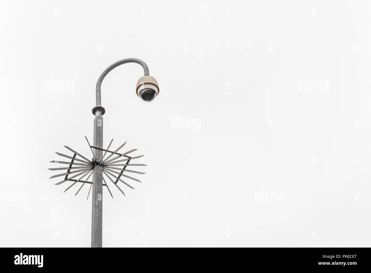 CCTV surveillance camera & bleak grey sky. Surveillance State & crime prevention metaphor, security system, privacy campaigners, face recognition. Stock Photo