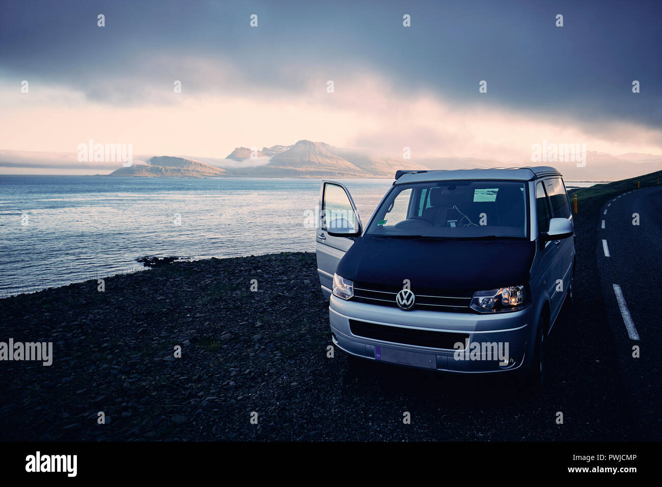 A VW California T5 camper van traveling the Iceland coastal road in south east Iceland.. Stock Photo