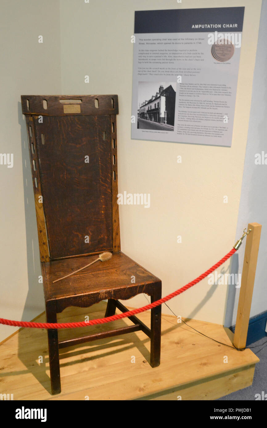 Amputation Chair at George Marshall Medical Museum, Worcestershire Royal Hospital, UK. Person was strapped to chair to have a limb sawn off. - Stock Image