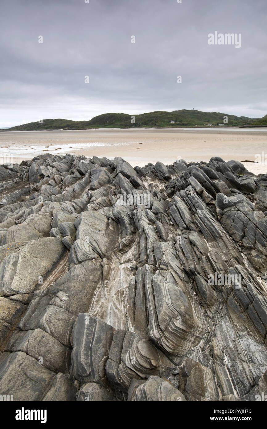 Metamorphic rock formations on Morar beach, west coast of Scotland - Stock Image