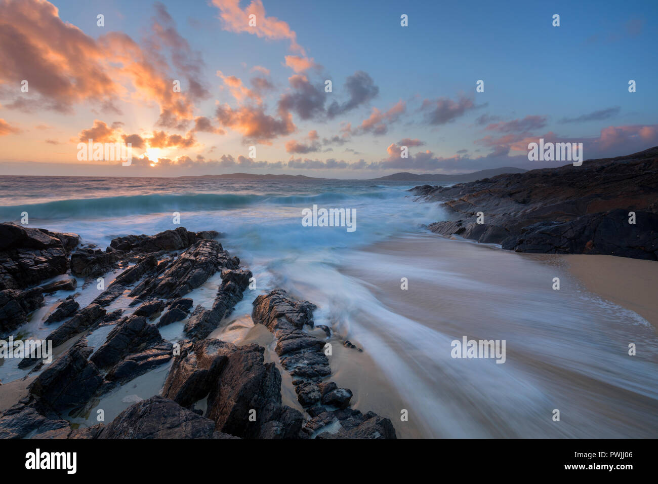 Receding wave in a small cove at sunset, Harris, Outer Hebrides, Scotland Stock Photo