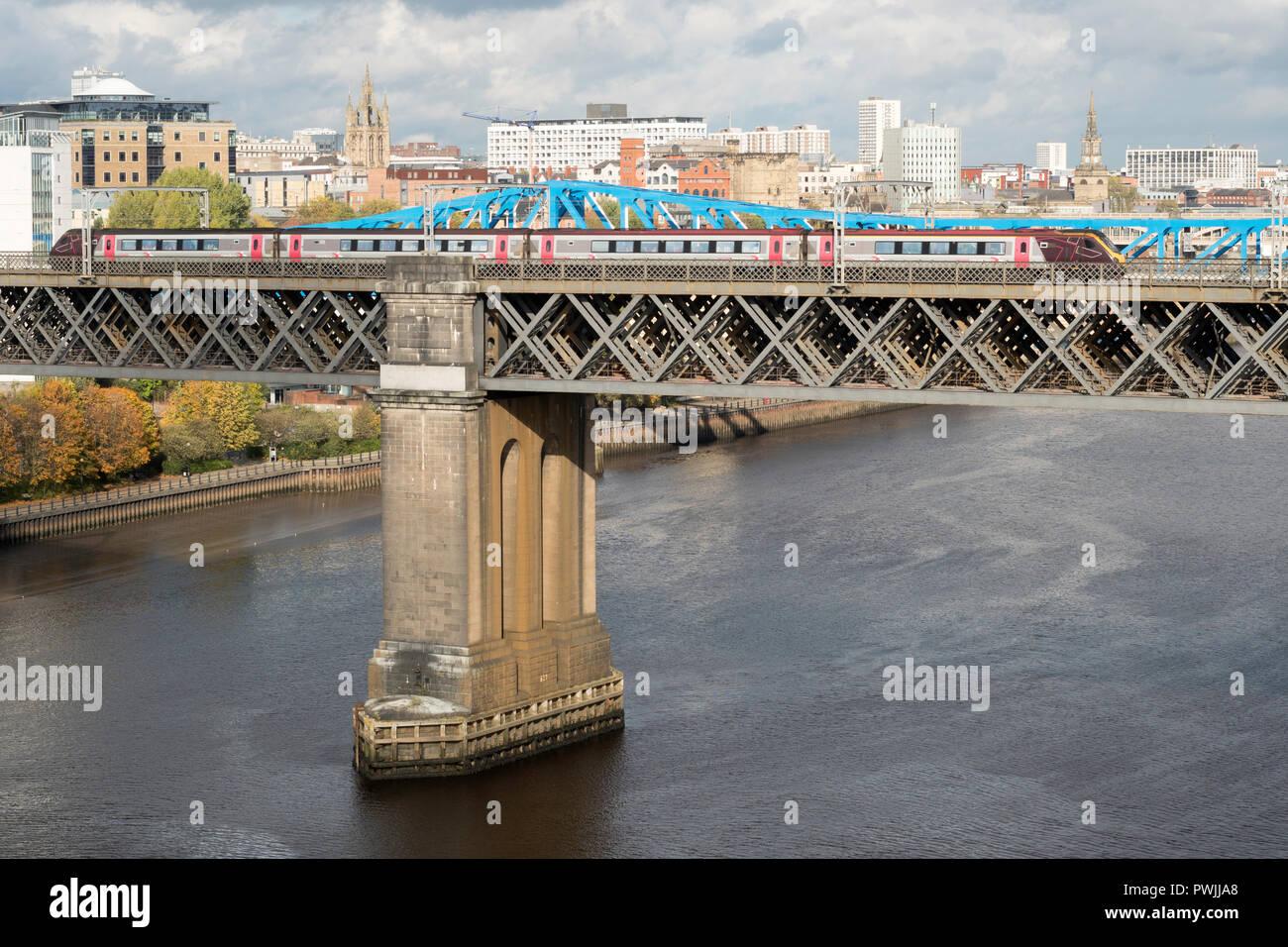 CrossCountry express passenger train crossing the King Edward Bridge over the river Tyne, Newcastle upon Tyne, England, UK - Stock Image