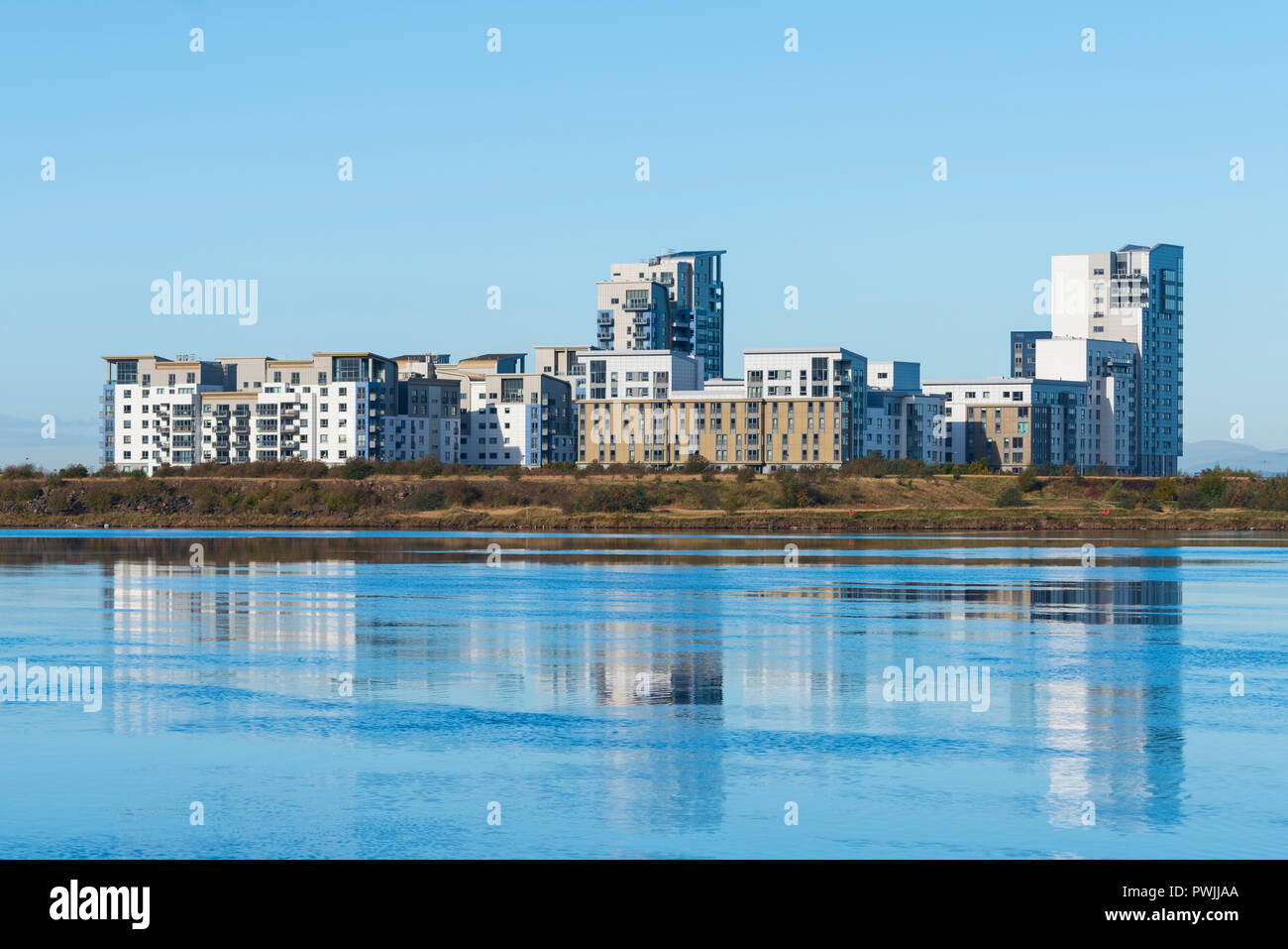 View of modern apartment buildings at Western Harbour housing development in Leith, Scotland, UK - Stock Image