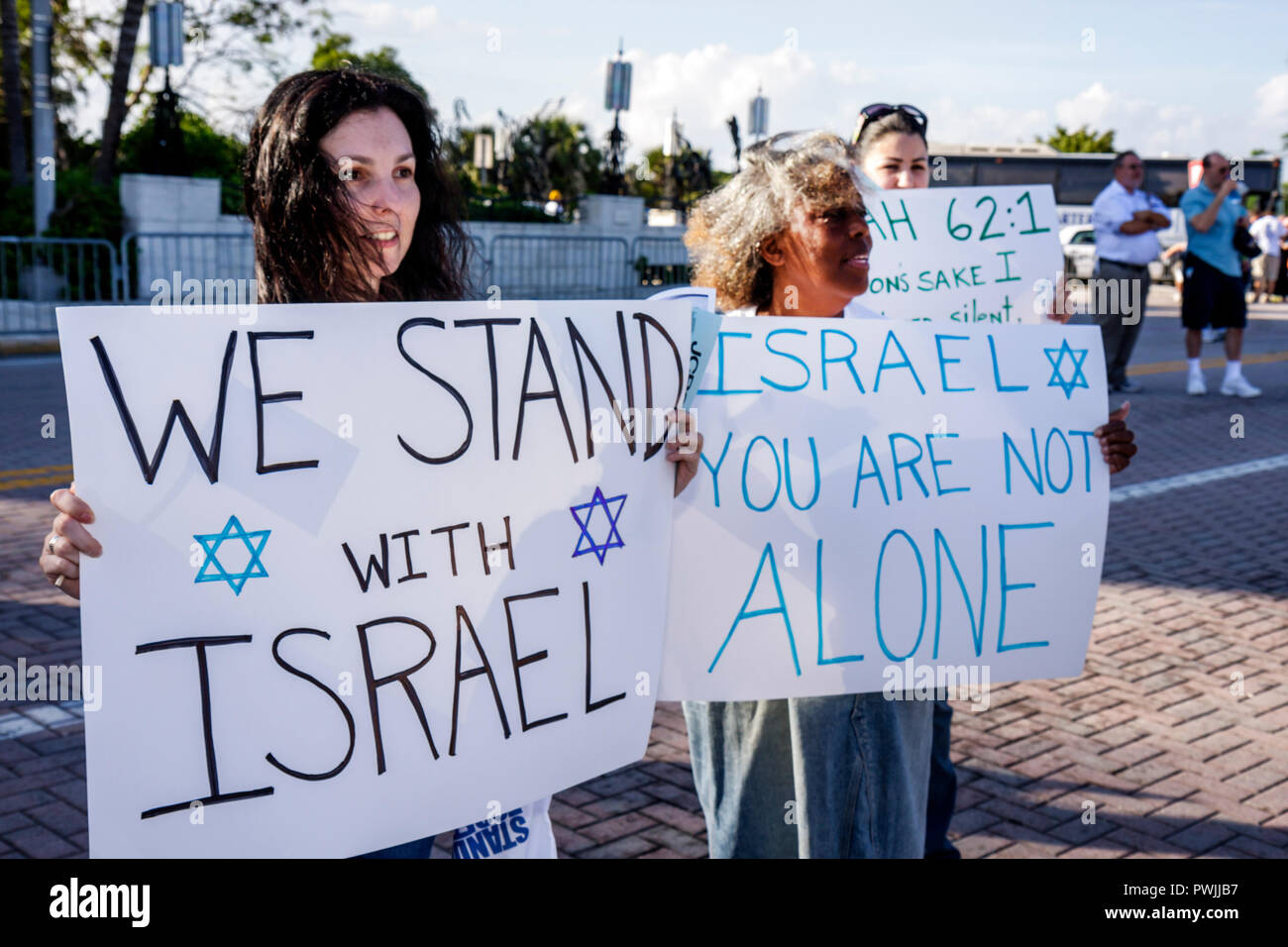 Miami Beach Florida Holocaust Memorial Israel Solidarity Rally Jews Jewish state Zionism religion tradition heritage woman women - Stock Image