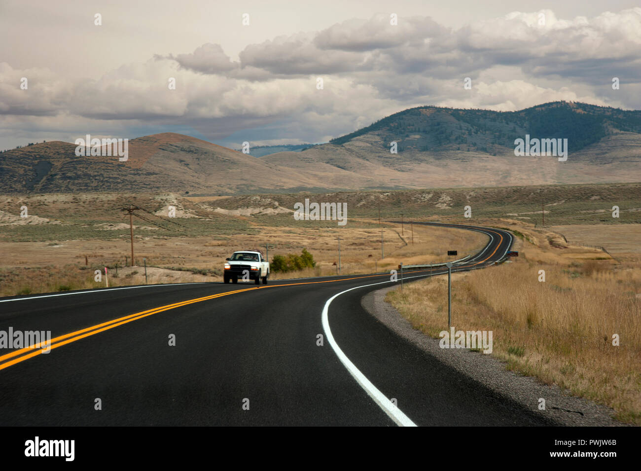 Pickup truck driving on an open road in Montana, USA - Stock Image