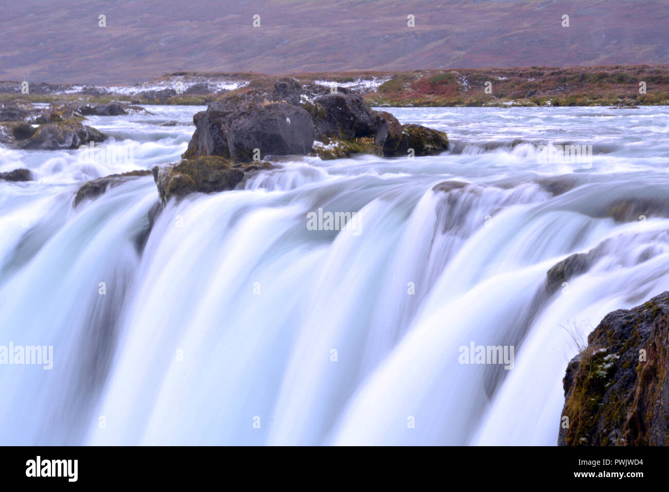Blurred Waterfall in Iceland - Stock Image