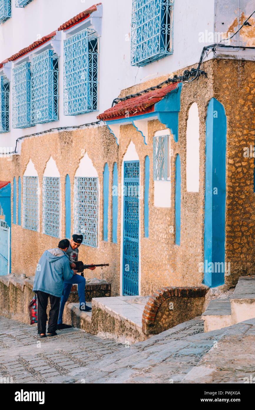 Man Strumming a Sintir aka Guembri, Chefchaouen, Morocco, 2018 - Stock Image