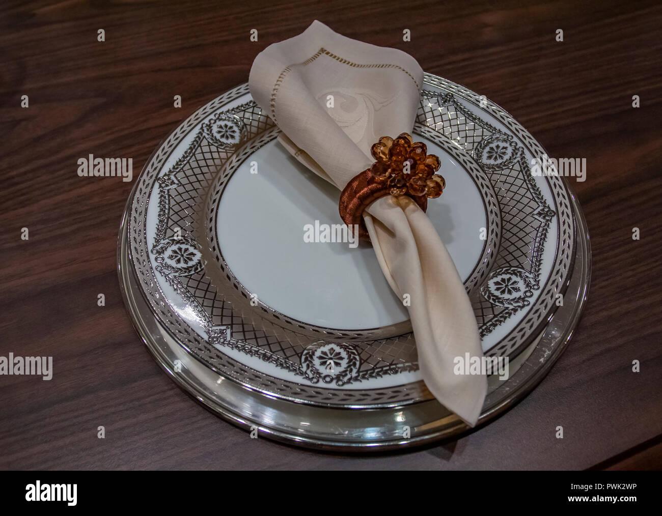 Empty plate with a napkin. Luxury wedding reception in restaurant. stylish decor and adorning. Stylish Napkin - Stock Image