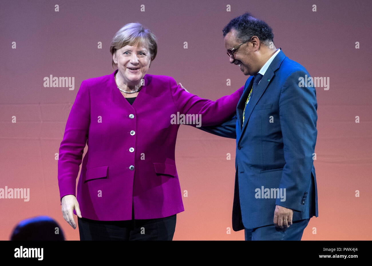 Berlin, Germany. 16 October 2018, Berlin: 16 October 2018, Germany, Berlin:Chancellor Angela Merkel (CDU) and Tedros Adhanom Ghebreyesus, Director General of the World Health Organization (WHO), will be on stage at the closing event of the World Health Summit 2018. Around 2,000 participants and 300 speakers from 100 countries discussed pressing issues of global health care and the prevention of preventable diseases at the three-day event. Photo: Bernd von Jutrczenka/dpa Credit: dpa picture alliance/Alamy Live News - Stock Image