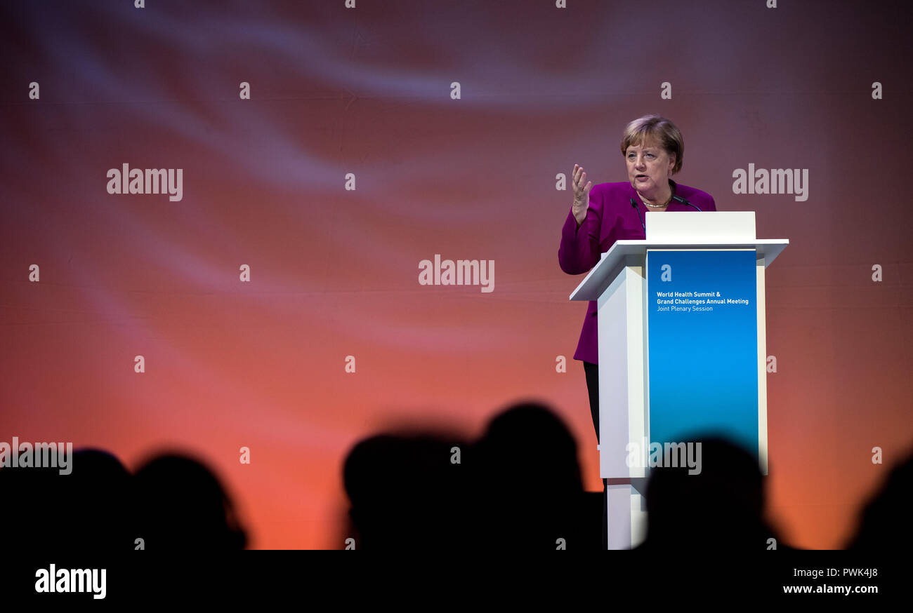 Berlin, Germany. 16 October 2018, Berlin: 16 October 2018, Germany, Berlin: Chancellor Angela Merkel (CDU) speaking at the closing event of the World Health Summit 2018. 2,000 participants and 300 speakers from 100 countries discussed pressing issues of global health care and the prevention of preventable diseases at the three-day event. Photo: Bernd von Jutrczenka/dpa Credit: dpa picture alliance/Alamy Live News - Stock Image