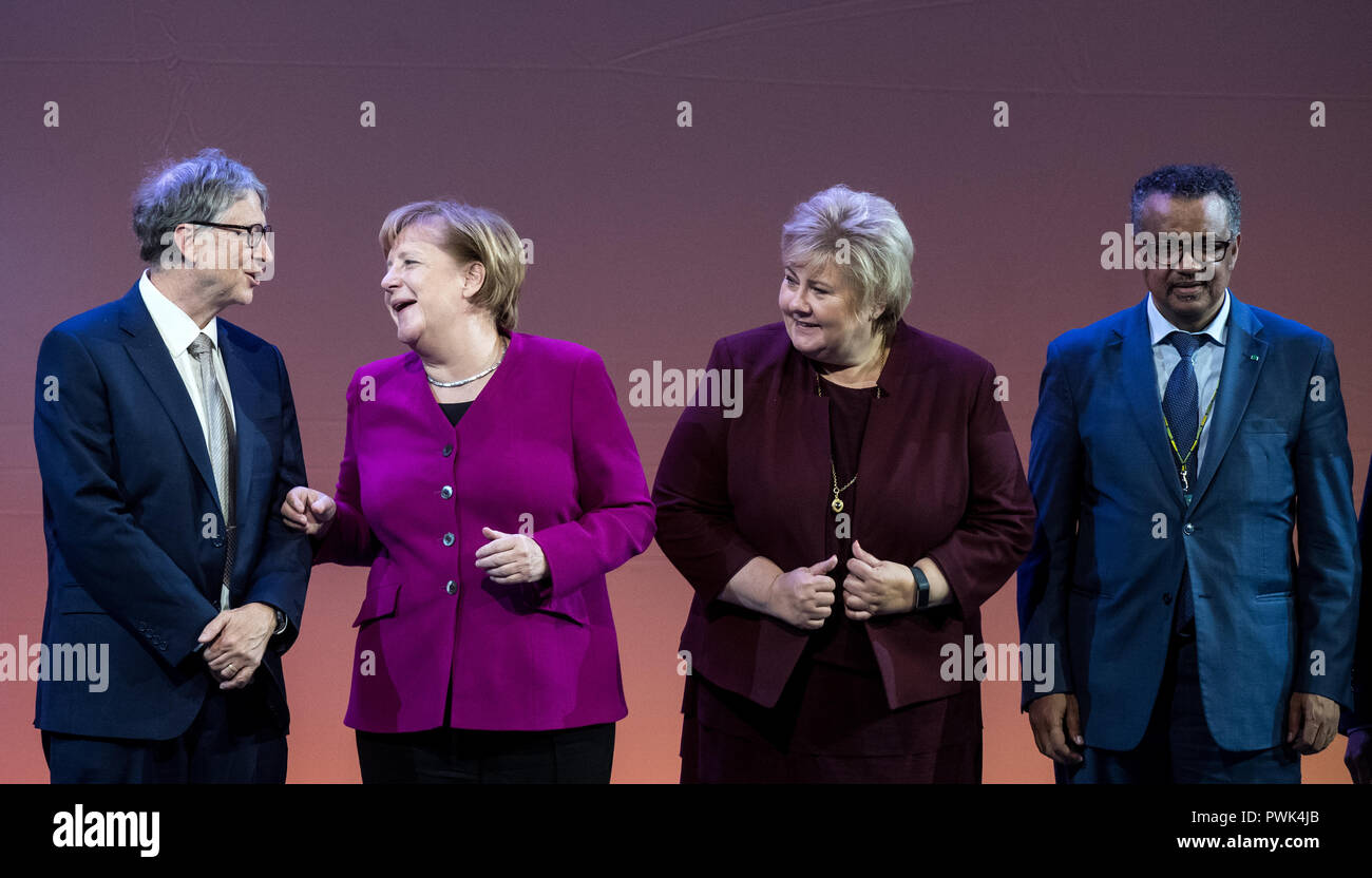 Berlin, Germany. 16 October 2018, Berlin: 16 October 2018, Germany, Berlin: Bill Gates (L-R), founder of Microsoft and the Bill & Melinda Gates Foundation, Chancellor Angela Merkel (CDU), Erna Solberg, Prime Minister of Norway, and Tedros Adhanom Ghebreyesus, Director General of the World Health Organization (WHO), are onstage at the closing event of the World Health Summit 2018. Around 2,000 participants and 300 speakers from 100 countries discussed pressing issues of global health care and the prevention of preventable diseases at the three-day event. Photo: Bernd von Jutrczenka/dpa Credit:  - Stock Image