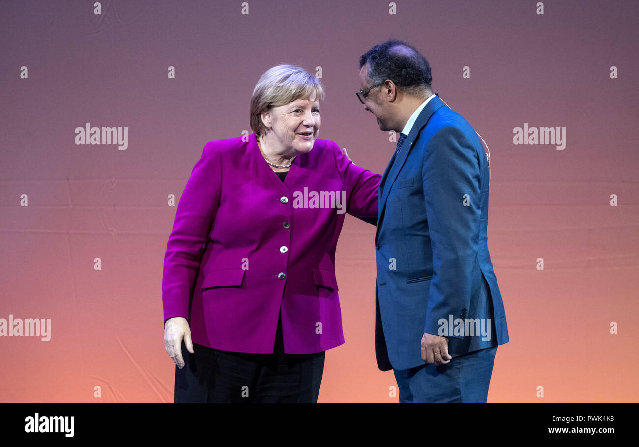 Berlin, Germany. 16 October 2018, Berlin: 16 October 2018, Germany, Berlin: Chancellor Angela Merkel (CDU) and Tedros Adhanom Ghebreyesus, Director General of the World Health Organization (WHO), will be on stage at the closing event of the World Health Summit 2018. Around 2,000 participants and 300 speakers from 100 countries discussed pressing issues of global health care and the prevention of preventable diseases at the three-day event. Photo: Bernd von Jutrczenka/dpa Credit: dpa picture alliance/Alamy Live News - Stock Image