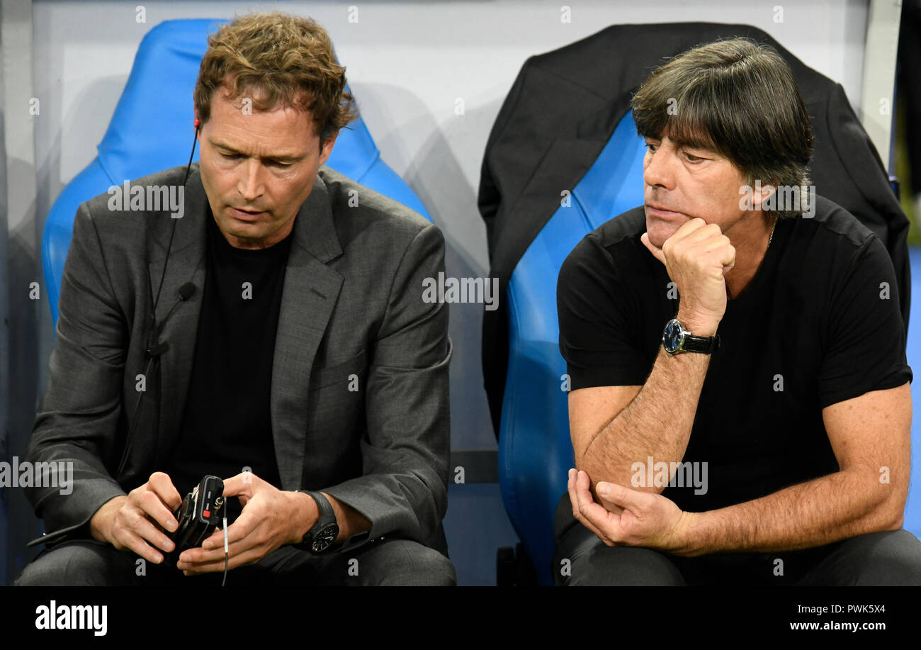 Paris, France. 16th Oct, 2018. 16 October 2018, France, Paris: Soccer: Nations League A, France - Germany, Group stage, Group 1, 4th matchday at the Stade de France. National coach Joachim Loew (R) and assistant coach Marcus Sorg from Germany are sitting on the bench in the stadium before the match. Credit: Ina Fassbender/dpa/Alamy Live News Stock Photo