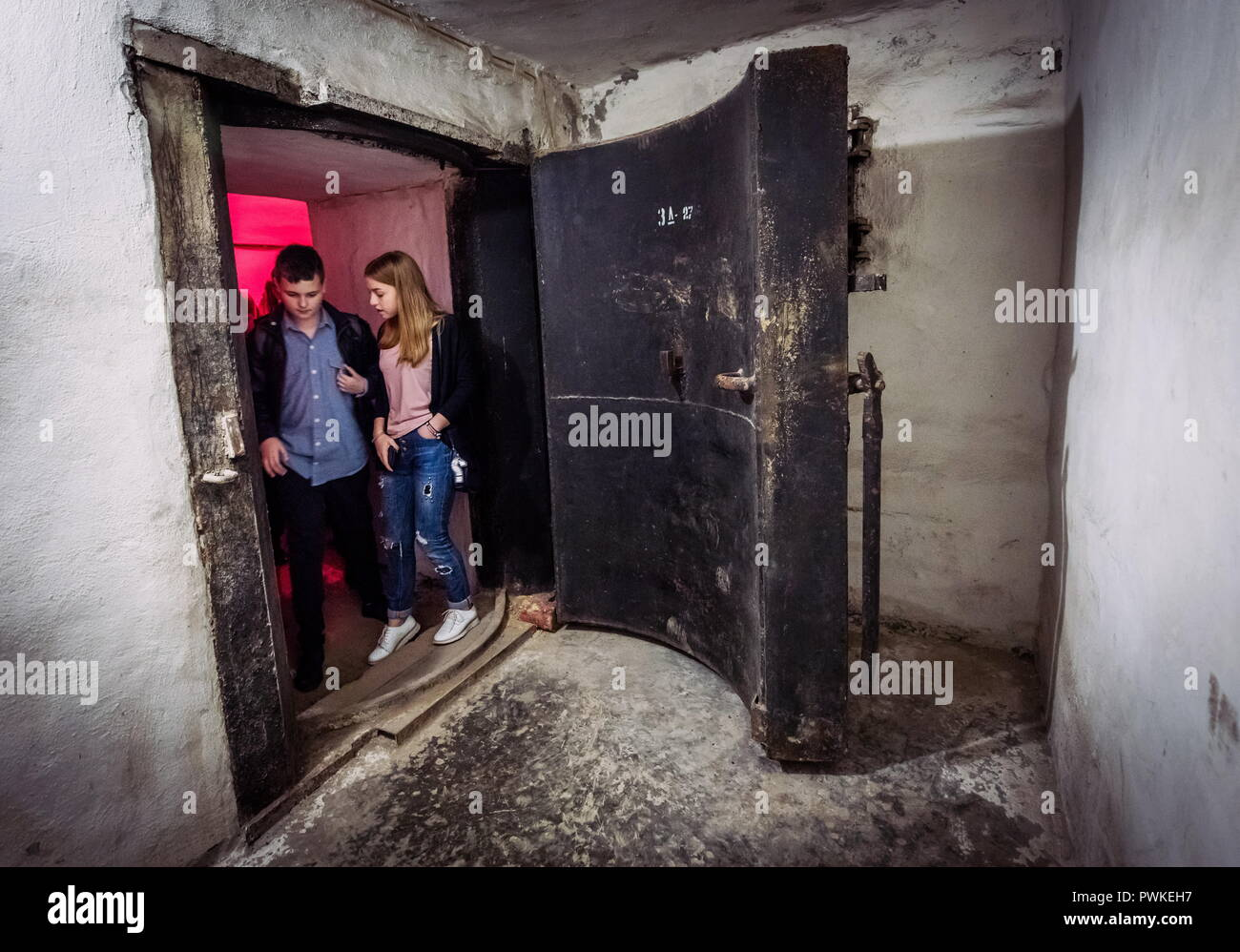 CRIMEA, RUSSIA - OCTOBER 16, 2018: People attend an excursion at the 'Underground Sevastopol' museum based at a functioning nuclear bunker under Sevastopol's city centre. The bunker rates first-class and is optimized for sheltering up to 1.000 people; it was built in 1952 but has never been used since. In case of emergency, the bunker can be prepared to shelter people in 12 hours. The nuclear bunker is part of an underground system of atomic shelters which can host the city's residents and authorities, as well as several plants and schools, in case of a nuclear attack. Sergei Malgavko/TASS - Stock Image