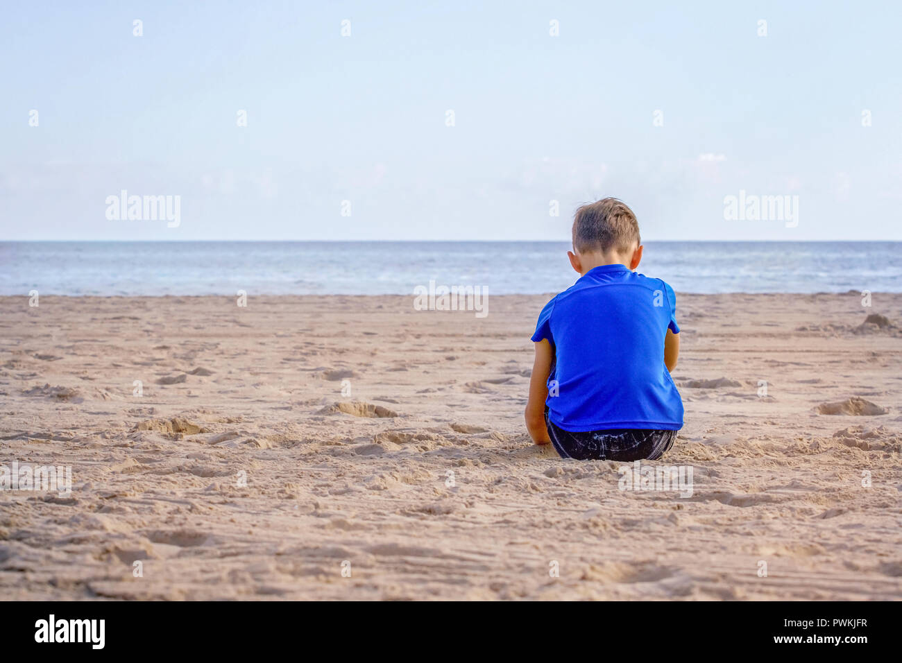 Sad boy beach stock photos sad boy beach stock images alamy