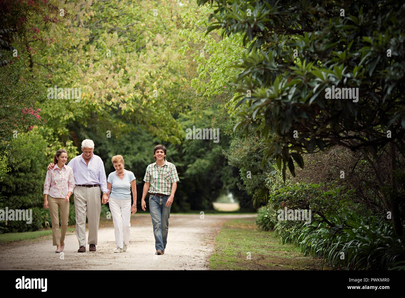 View of a family taking a leisurely walk. - Stock Image
