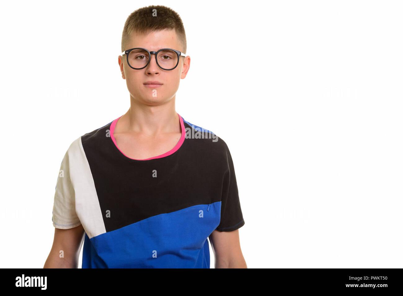 Studio shot of young Caucasian nerd man with eyeglasses - Stock Image