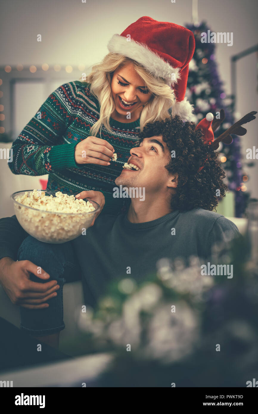 Loving Couple In Cozy Warm Sweaters On A Christmas New Year Eve