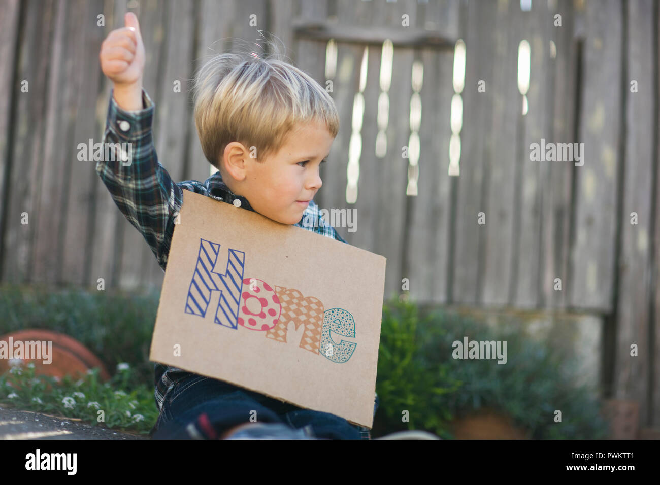 Young boy pretending to hitchhike. - Stock Image