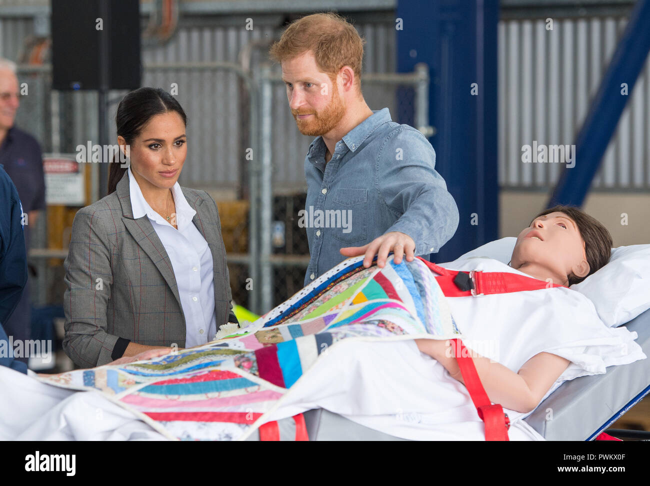 The Duke and Duchess of Sussex look at a medical training