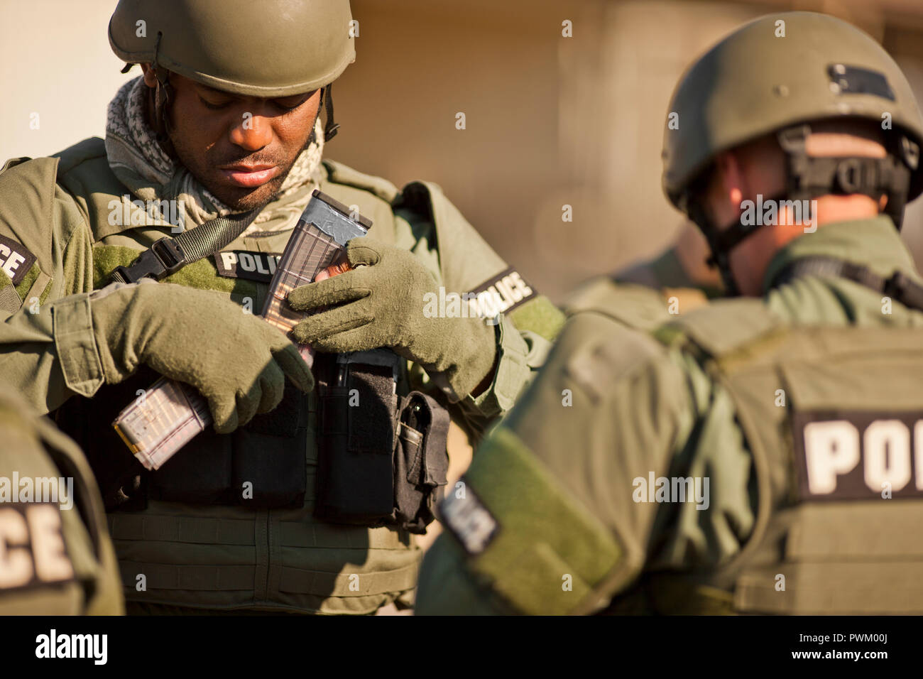 Two police officers at a training facility. - Stock Image