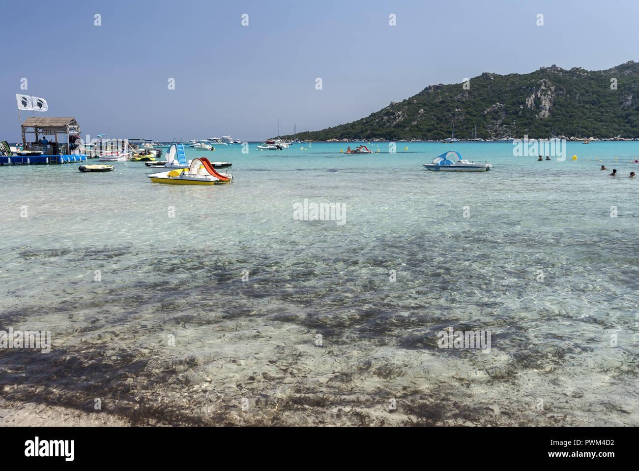 Tourist recreational water vehicles in the bay of Santa Giulia. Beach of Santa Giulia in Corsica. Plaża Santa Giulia na Korsyce. - Stock Image