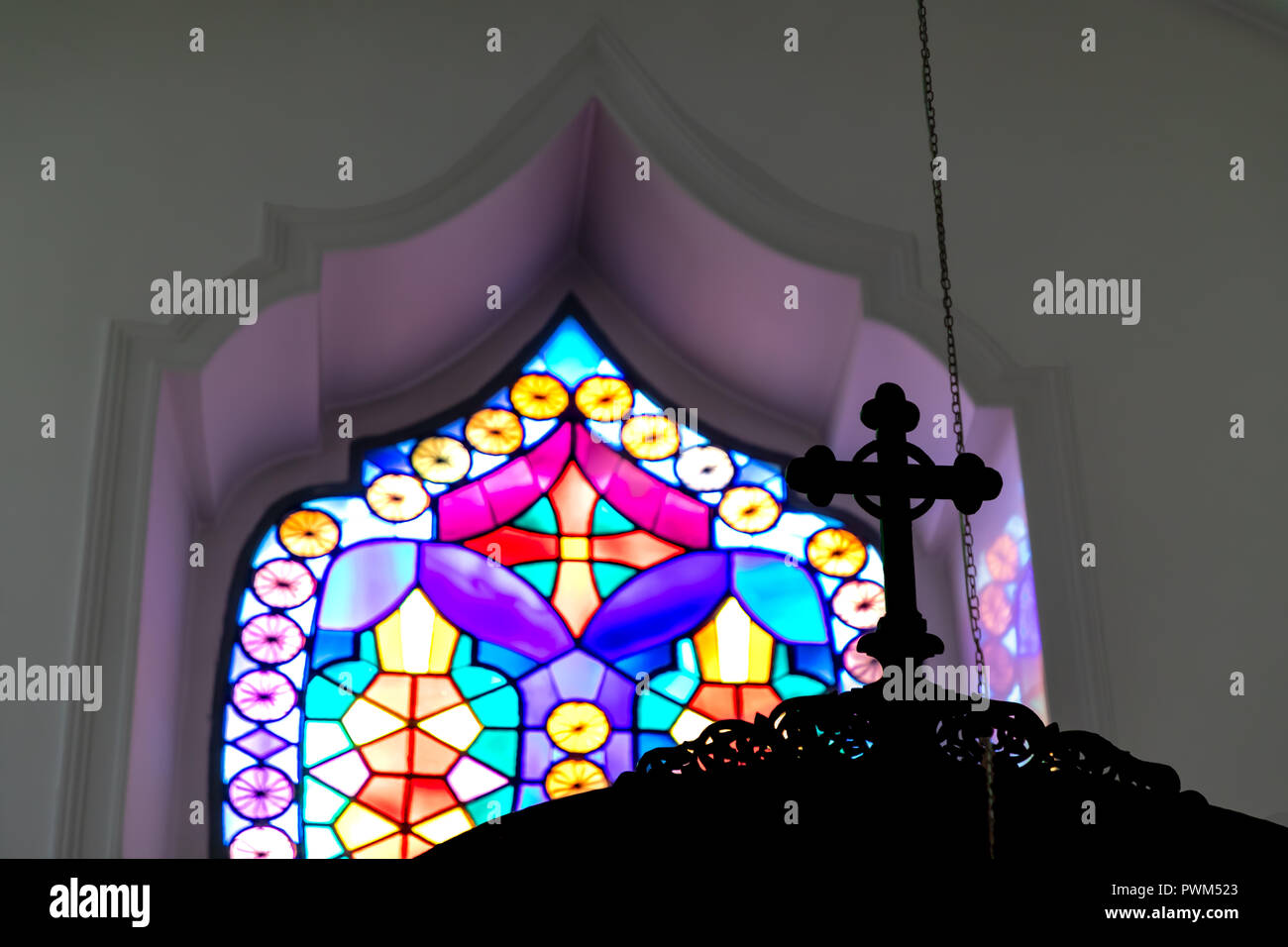 Stain Glass and Cross Silhouette. - Stock Image
