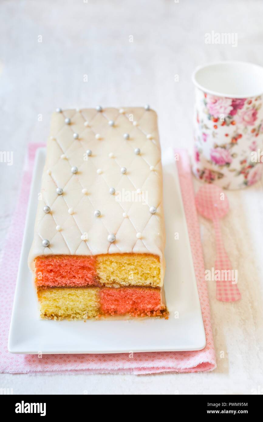 Battenberg cake with marzipan and edible silver beads - Stock Image