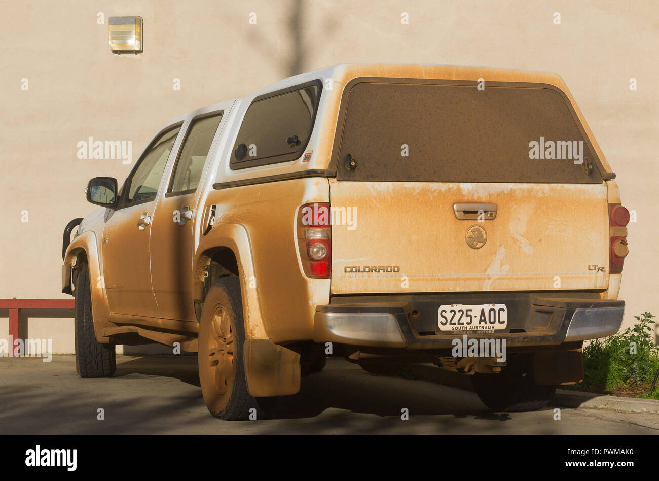 White Holden Colorado car covered in a thick layer of dust on Kangaroo Island in South Australia, Australia. - Stock Image