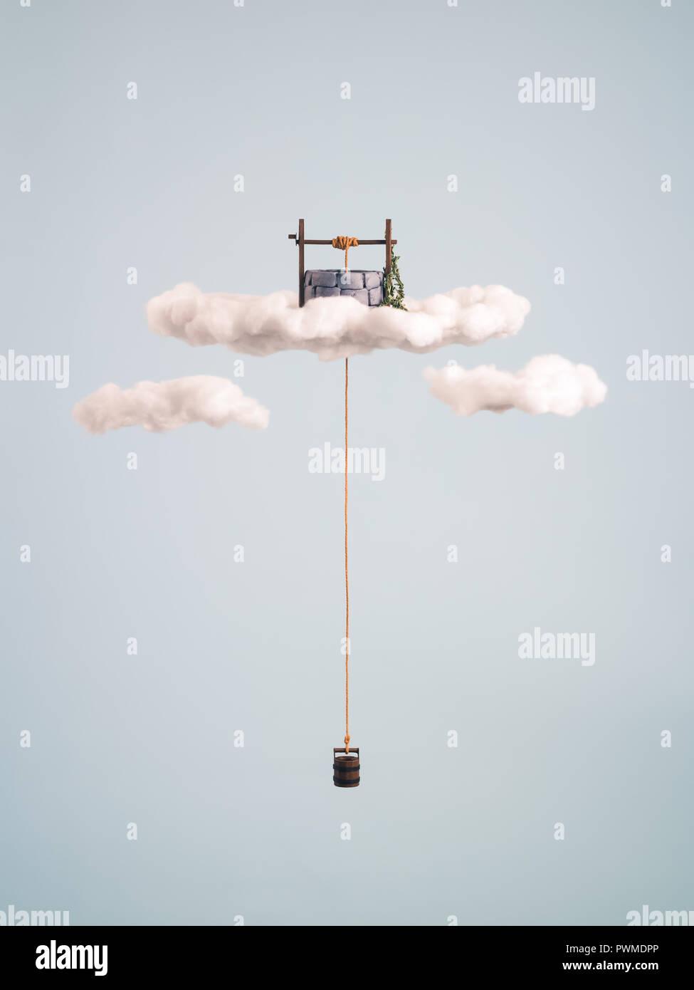 Wishing well floating on the sky - Stock Image