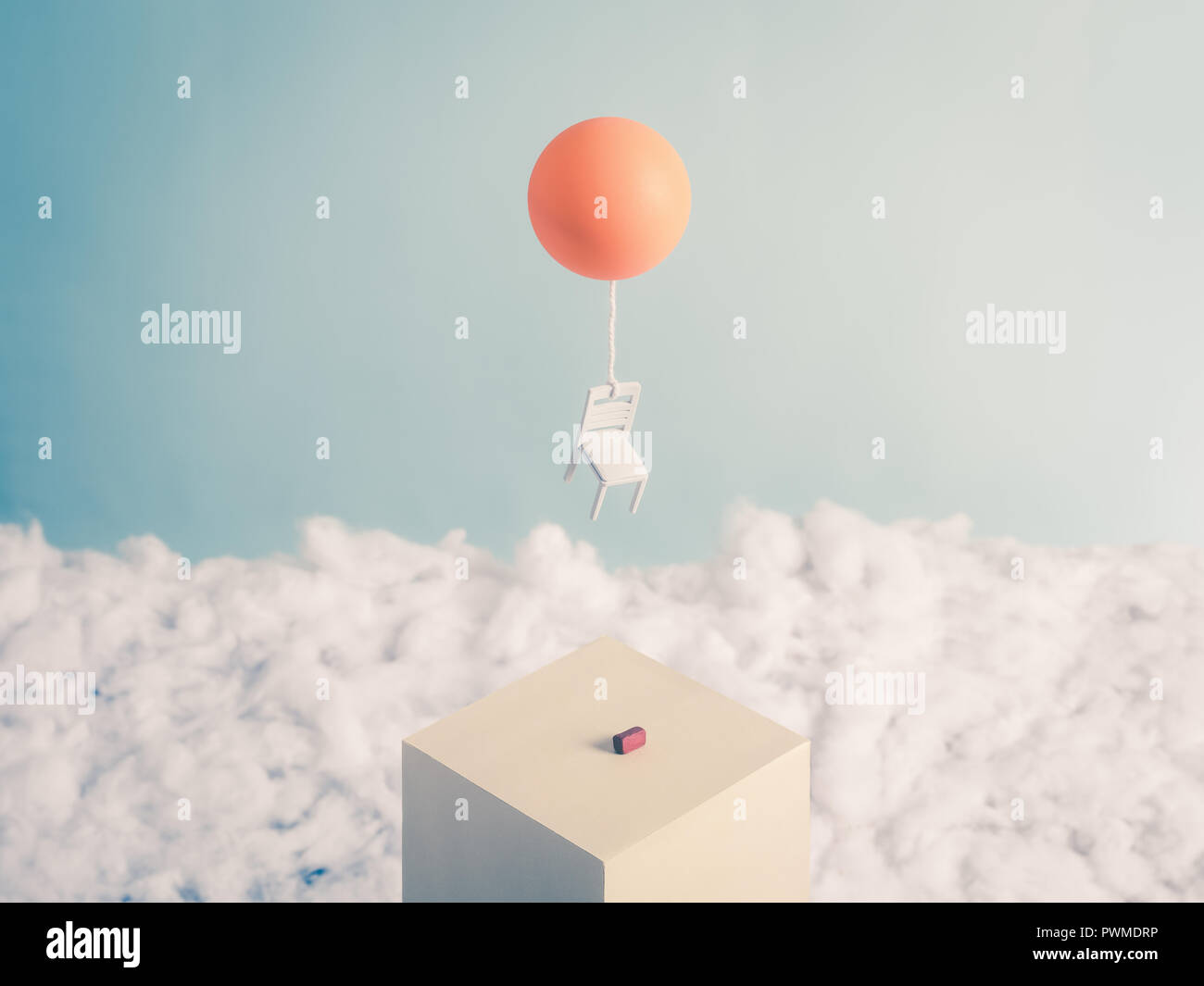 Chair and a Balloon, flying into the sky free from its burden, a brick - Stock Image
