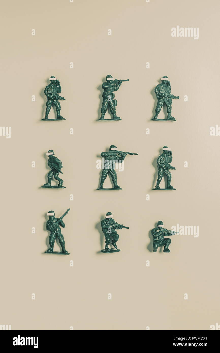 Greem army men toy with censored faces - Stock Image