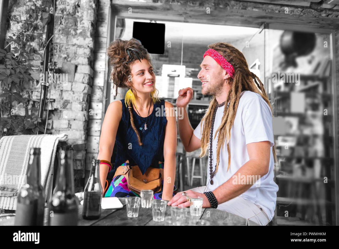 Bearded man with dreadlocks falling in love with his beautiful girlfriend - Stock Image