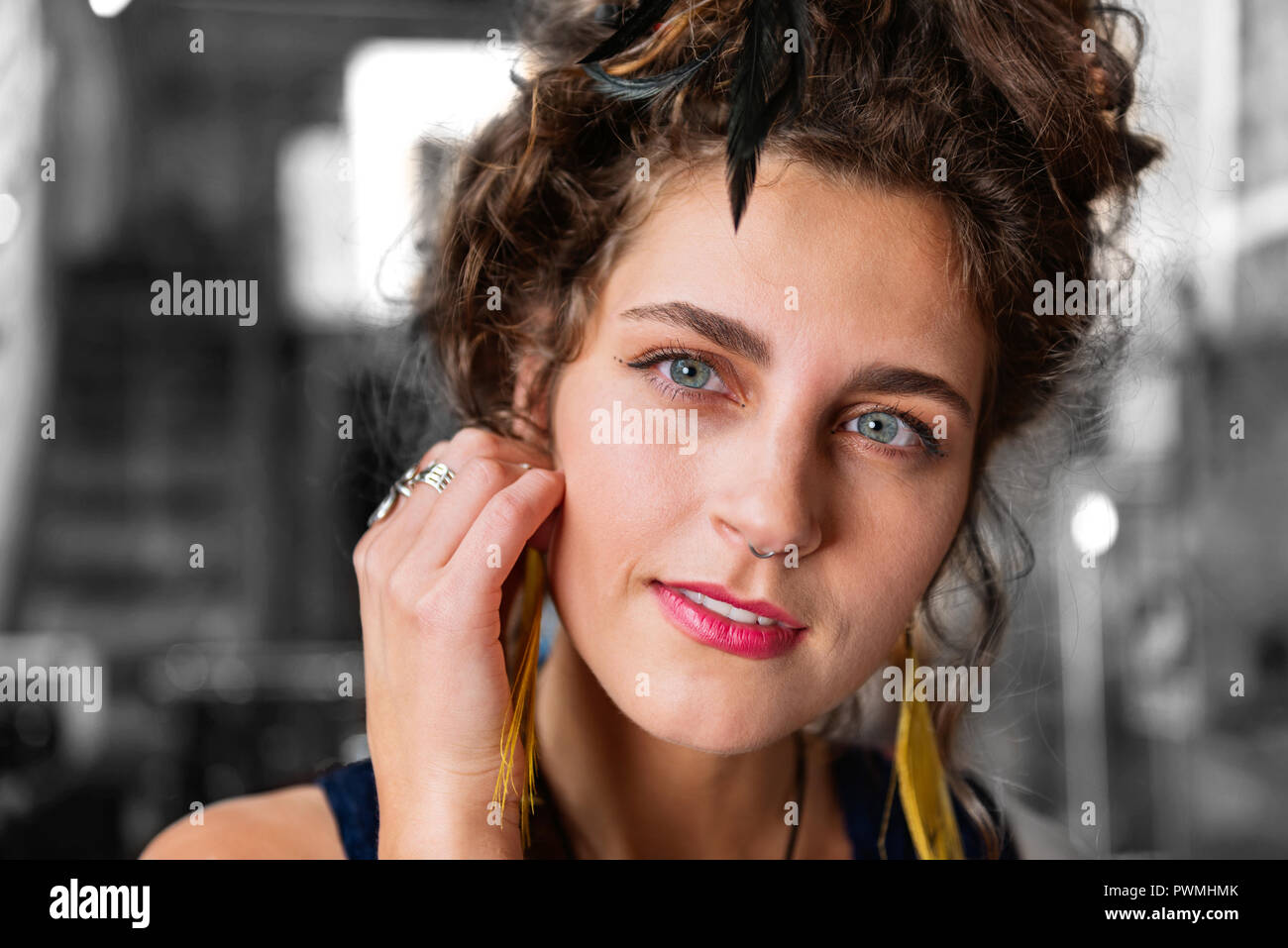 Stylish modern woman with piercing in her nose wearing stylish accessories - Stock Image