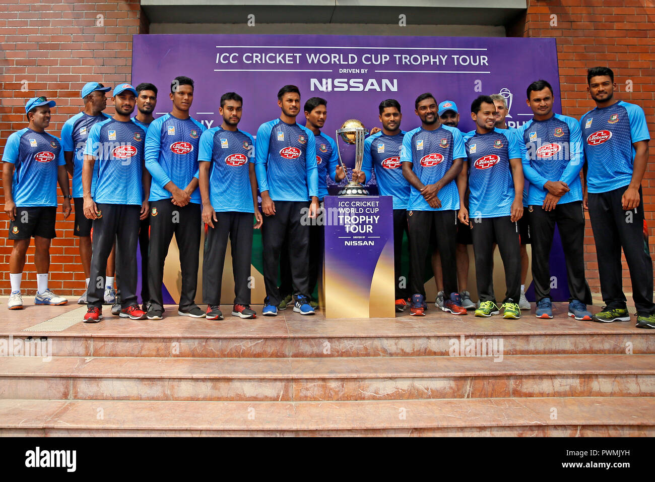 Bangladesh Cricket Team Players possesses for photographs along the ICC Cricket World Cup Trophy at BCB premises in Mirpur, during its tour to Banglad - Stock Image