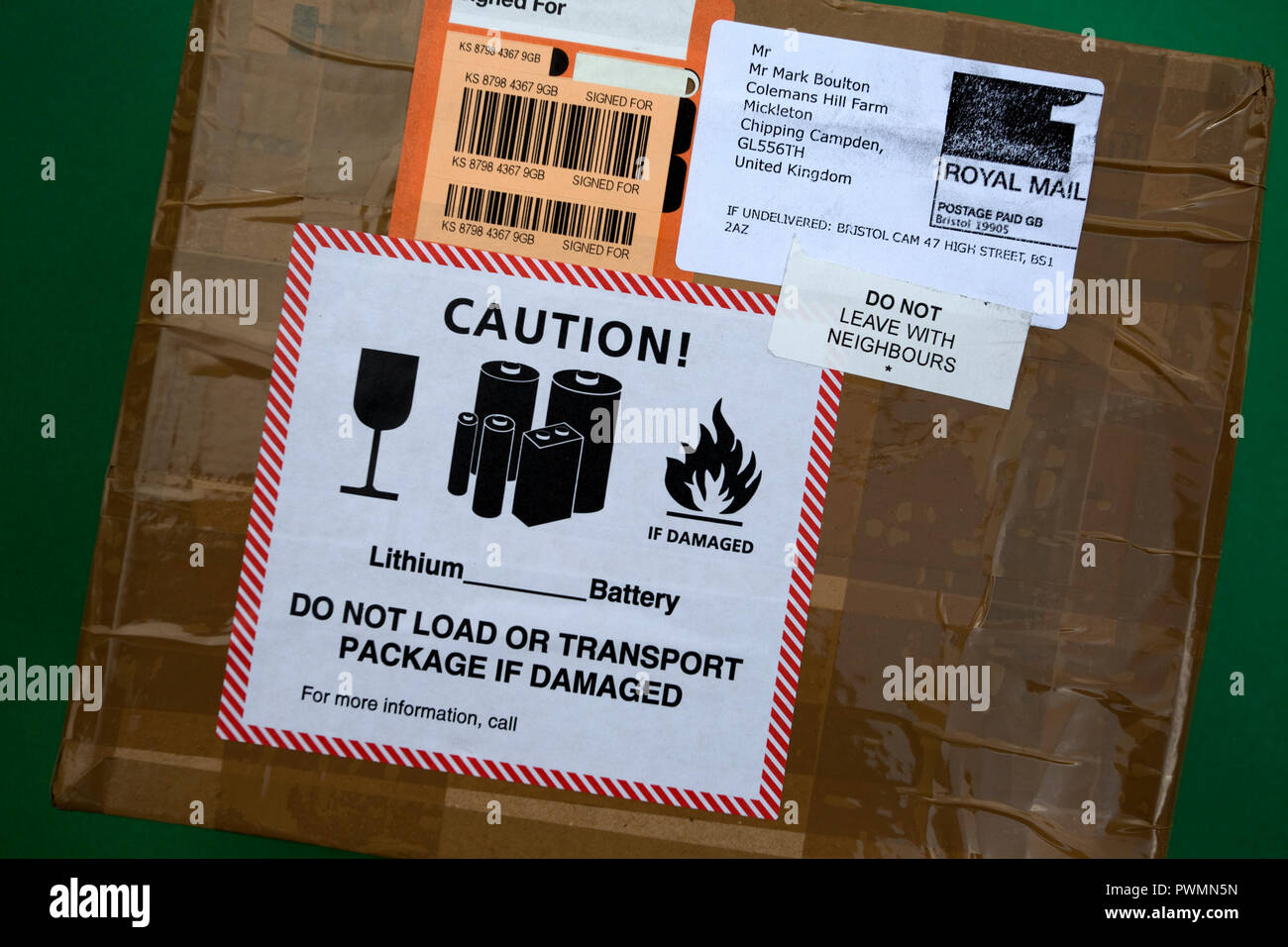 Caution Lithium battery label on postal package UK - Stock Image