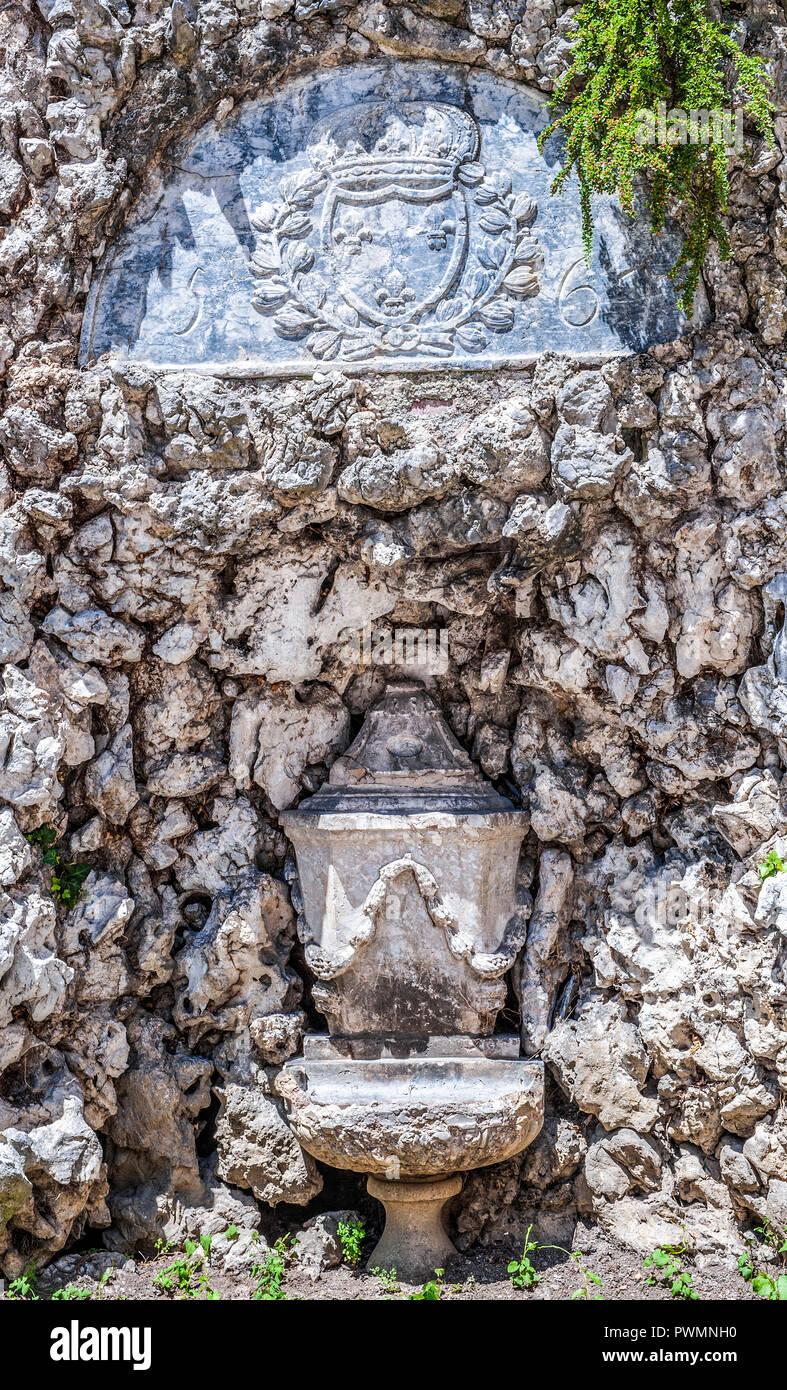 France, Occitanie region, Hautes-Pyrenees, spa town of Bagneres-de-Bigorre, fountain of St Jean Cloister Stock Photo