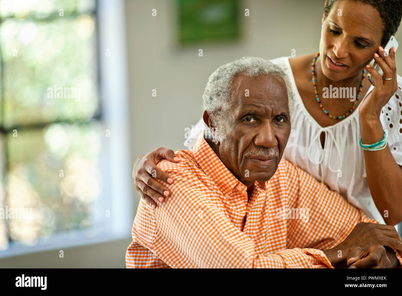 Happy senior man spending time with his middle aged son. - Stock Image