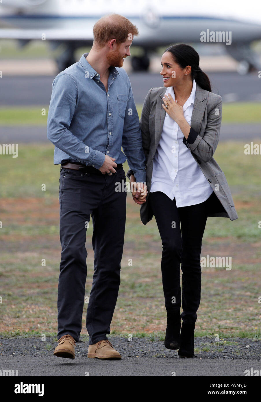 The Duke and Duchess of Sussex arrive at Dubbo airport, in Australia, on the second day of their tour to the country. Stock Photo