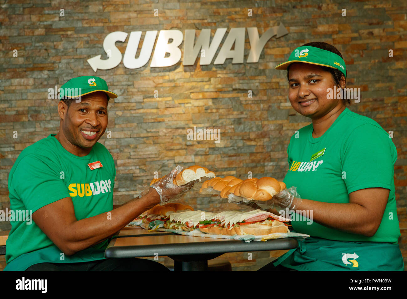 407d66ad8a6b1 Subway Sandwich Artists Justin Pringle and Yasoda Jayaweera make a BMT  Giant Sub for the wedding reception of James and Lucinda Coad at Abbotts  Hill School ...