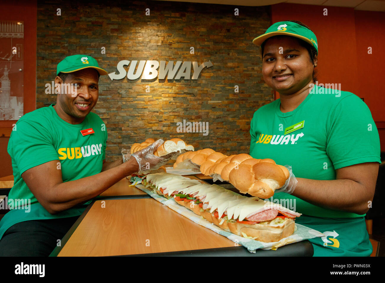 5c6dab6e36b94 Subway Sandwich Artists Justin Pringle and Yasoda Jayaweera make a BMT  Giant Sub for the wedding ...